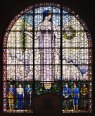 Grant Wood, Veterans Memorial Window, 1929. The bid to fabricate the glass for Wood's ambitious window was awarded to the Emil Frei art glass company in St. Louis. However, due to the intricate detail of Wood's design, the glass ultimately had to be manufactured in Munich, Germany. Wood traveled to Munich to supervise production; while there, he encountered the work of late medieval artists, eventually producing his best-known painting, American Gothic, as a result. However, the Daughters of American Revolution accused Wood of being unpatriotic for allowing a German firm to manufacture materials for a U.S. veterans memorial so soon after World War I. Due to the controversy, the work was not dedicated publicly until its restoration was completed in 2010 following the flooding of 2008. Image courtesy of the Veterans Memorial Commission, Cedar Rapids.