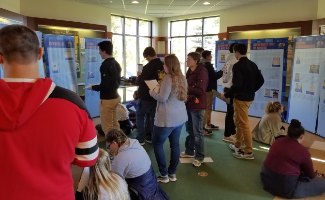 Waukee High School students tour the GIGM exhibit.